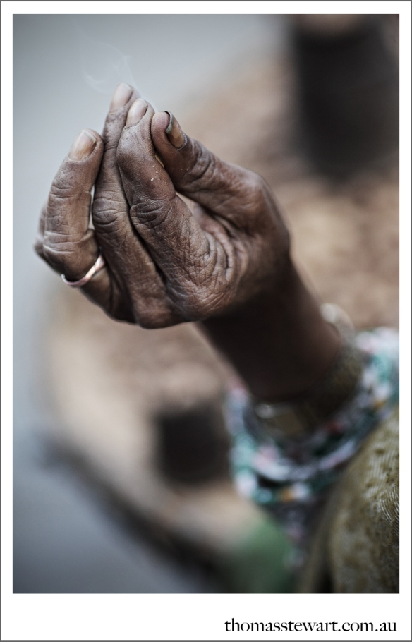 hand of a peanut seller in kathmandu, nepal
